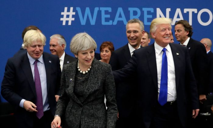 (L-R) British Secretary for Foreign Affairs Boris Johnson, Britain's Prime Minister Theresa May, NATO Secretary General Jens Stoltenberg, and President Donald Trump arrive for a working dinner meeting at the NATO (North Atlantic Treaty Organization) summit at the NATO headquarters, in Brussels, on May 25, 2017.  (MATT DUNHAM/AFP/Getty Images)