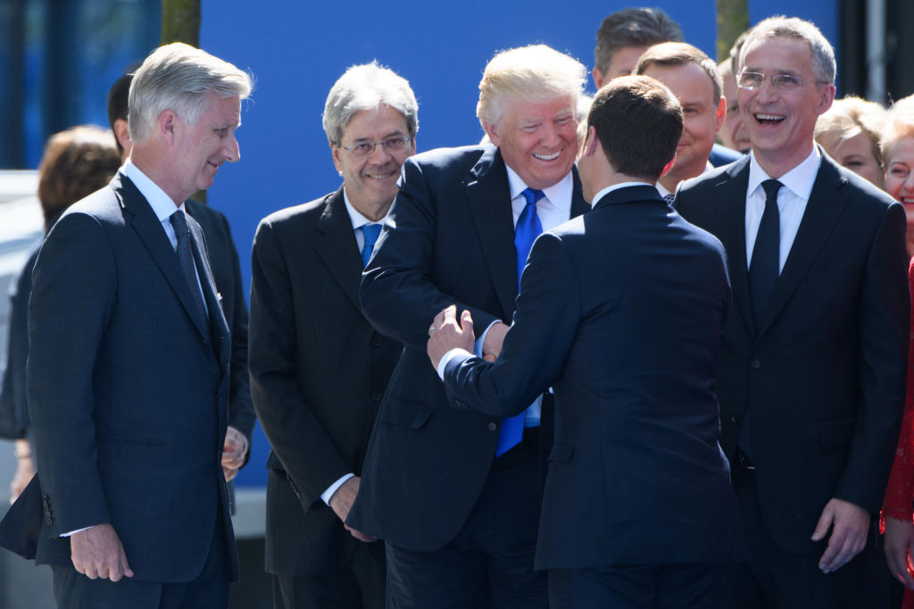 (L-R) Belgium's King Philip, Italian Prime Minister Paolo Gentiloni, President Donald Trump, French President Emmanuel Macron and NATO Secretary General Jens Stoltenberg attend the unveiling ceremony of the new NATO headquarters in Brussels, on May 25, 2017. (CHRISTOPHE LICOPPE/AFP/Getty Images)