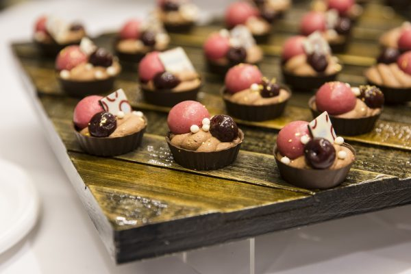 Cherry cremeux and coffee crunch in a chocolate shell. (Samira Bouaou/The Epoch Times)