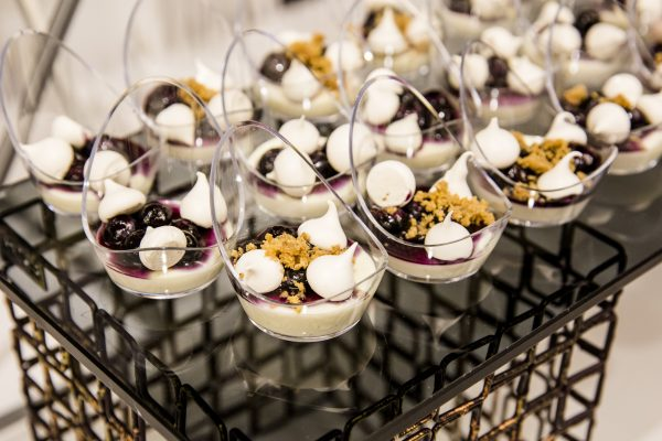 Citrus panna cotta with lemon verbena and blueberry compote, by pastry chef Michael Mignano. (Samira Bouaou/The Epoch Times)