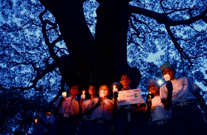 Children participate at a candlelight vigil held as part of a 'Save Trees' awareness rally in Bangalore, India, on June 7, 2017. (MANJUNATH KIRAN/AFP/Getty Images)