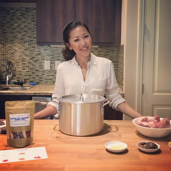 Cindy Mai in the kitchen. (Photo courtesy of root + spring).