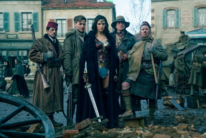 """(L-R) Saïd Tagmaoui as Sameer, Chris Pine as Steve Trevor, Gal Gadot as Diana, Eugene Brave Rock as The Chief and Ewen Bremner as Charlie in the action adventure """"Wonder Woman."""" (Clay Enos/TM & DC Comics)"""