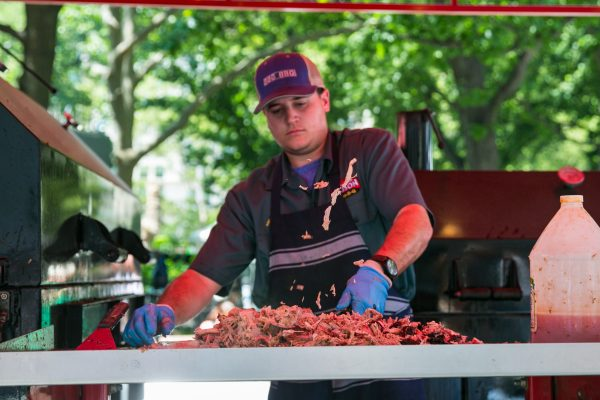 Chopping pulled pork at the Big Bob Gibson BBQ stand. (Benjamin Chasteen/The Epoch Times)