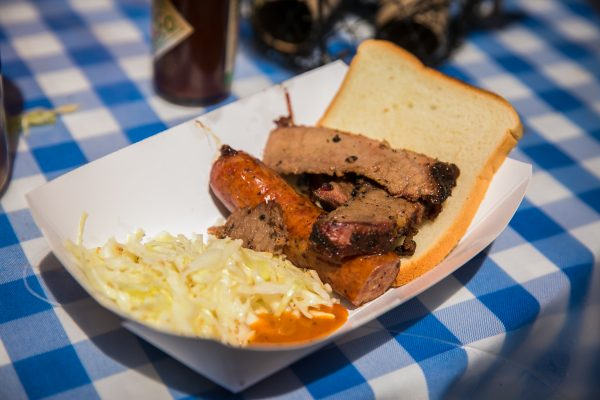 Brisket with sausage and sesame coleslaw from Salt Lick BBQ. (Benjamin Chasteen/The Epoch Times)