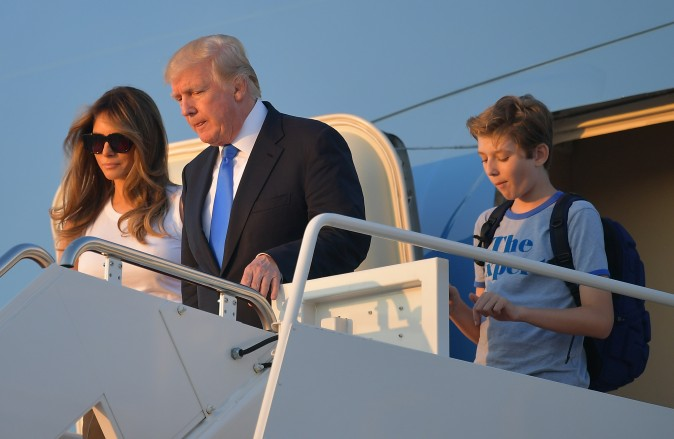 US President Donald Trump (C), first lady Melania Trump, and their son Barron Trump walk off  Air Force One after arriving at Andrews Airforce base, Maryland on June 11 2017.  Trump is returning to Washington, DC after spending the weekend at this Bedminster, New Jersey golf club. / AFP PHOTO / MANDEL NGAN        (Photo credit should read MANDEL NGAN/AFP/Getty Images)