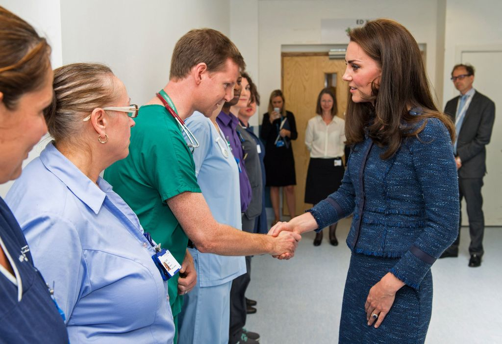 Britain's Catherine, Duchess of Cambridge (R), speaks to Dr Mark Haden as she visits Kings College Hospital to meet staff and patients affected by the terrorist attacks at London Bridge and Borough Market on June 3, in south London on June 12, 2017. (DOMINIC LIPINSKI/AFP/Getty Images)