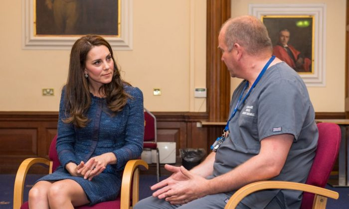 Britain's Catherine, Duchess of Cambridge (L), speaks to Clinical Director and Consultant in Emergency Medicine Dr Malcolm Tunnicliff as she visits Kings College Hospital to meet staff and patients affected by the terrorist attacks at London Bridge and Borough Market on June 3, in south London on June 12, 2017(DOMINIC LIPINSKI/AFP/Getty Images)