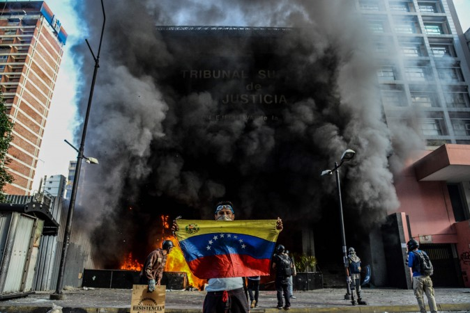 Anti-government demonstrators attack the administration headquarters of the Supreme Court of Justice as part of protests against President Nicolas Maduro in Caracas, Venezuela, on June 12, 2017. With Venezuelans suffering from high inflation, food shortages and soaring crime rates, plus a deepening corruption scandal, the Venezuelan opposition has mounted near-daily anti-government protests since April 1. (FEDERICO PARRA/AFP/Getty Images)