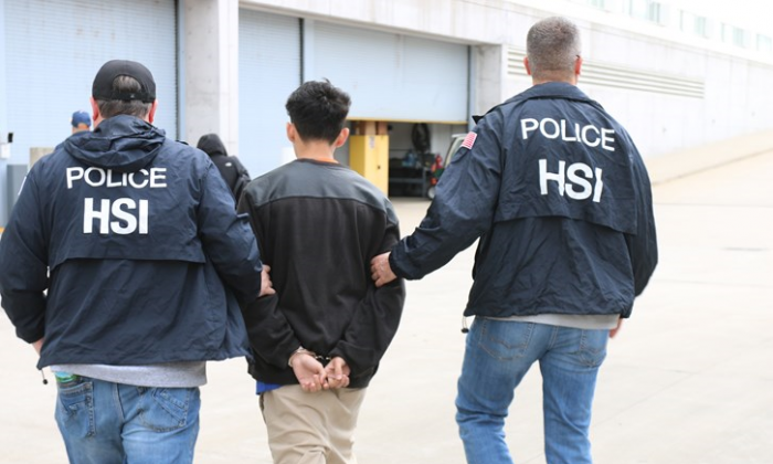 """A gang member is arrested during """"Operation Matador,"""" a gang sweep in the New York City area by local, state, and federal agencies, June 2017. (ICE)"""