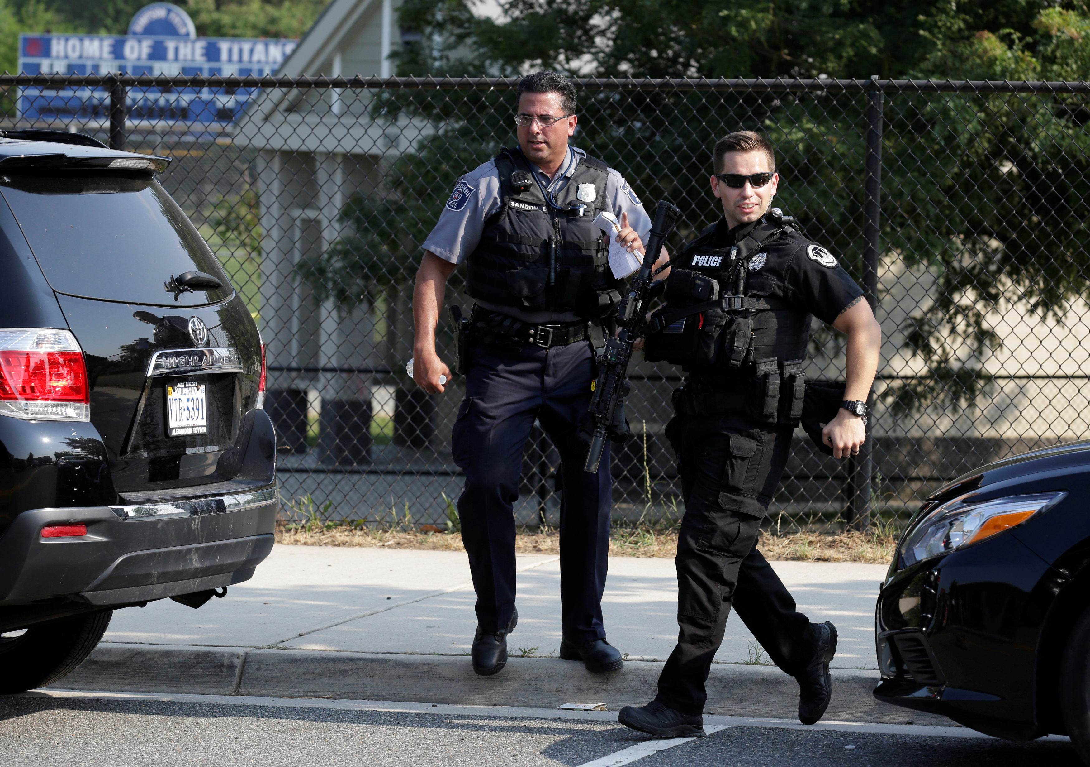 Police investigate a shooting scene after a gunman opened fire on Republican members of Congress during a baseball practice near Washington in Alexandria, Virginia. (REUTERS/Joshua Roberts)
