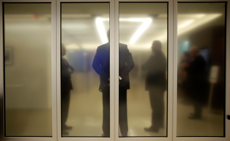 People wait for Federal Reserve Board Chairwoman Janet Yellen to attend a news conference after the Fed releases its monetary policy decisions in Washington on June 14, 2017. (REUTERS/Joshua Roberts)