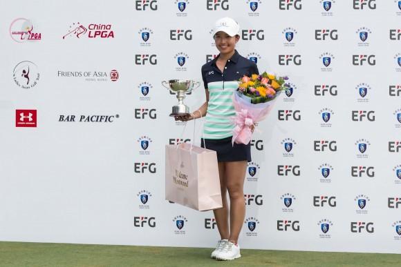 Hong Kong Olympic golfer and defending champion, Tiffany Chan collect the Hong Kong Cup for the leading Hong Kong player in EFG Hong Kong Ladies Open at Hong Kong Golf Club, Fanling on Sunday 11, 2017. (Dan Marchant)