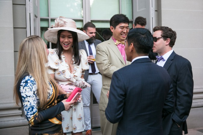 Guests mingle at the Frick's Fifth Avenue Garden. (Benjamin Chasteen/The Epoch Times)