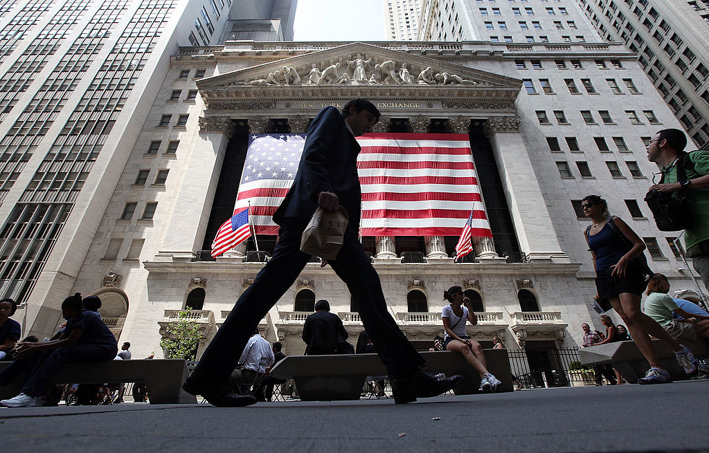 People walk past the New York Stock Exchange during afternoon trading  in New York City on Aug. 4, 2011. (Mario Tama/Getty Images)