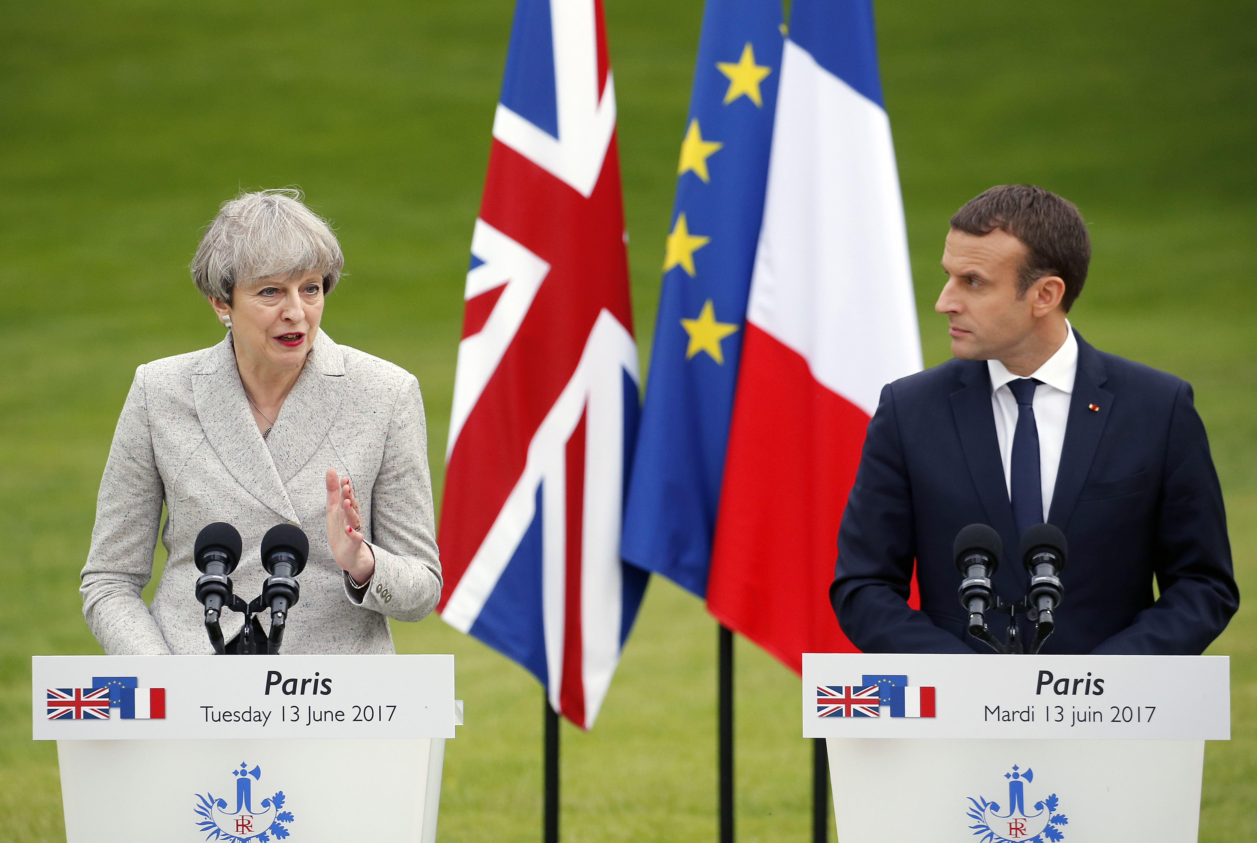 British Prime Minister Theresa May gives a joint press conference with French President Emmanuel Macron in Paris on June 13. May's negotiating position for Brexit has weakened following the elections. (Thierry Chesnot/Getty Images)