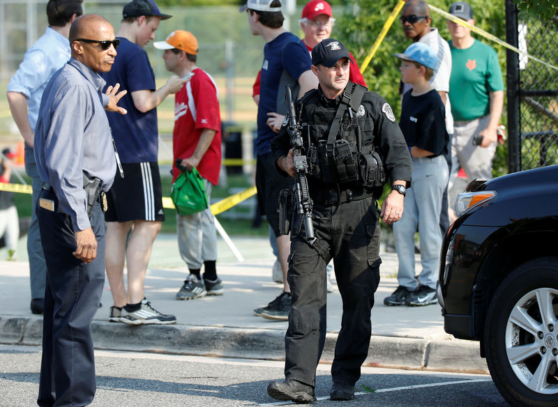 Police investigate a shooting scene after a gunman opened fire on Republican members of Congress during a baseball practice near Washington in Alexandria, Virginia on  June 14, 2017. (REUTERS/Joshua Roberts)