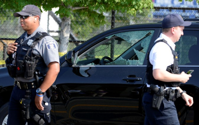 A vehicle window is shattered as police secure the scene where shots were fired during a Congressional baseball practice, wounding House Majority Whip Steve Scalise (R-LA), in Alexandria, Virginia, U.S., June 14, 2017. REUTERS/Mike Theiler
