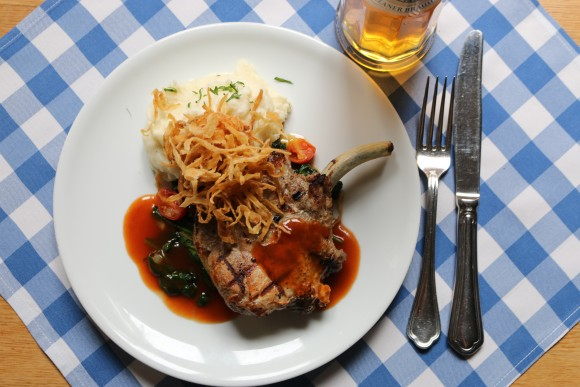 Bone-in pork chop in beer sauce. (Courtesy of Paulaner)
