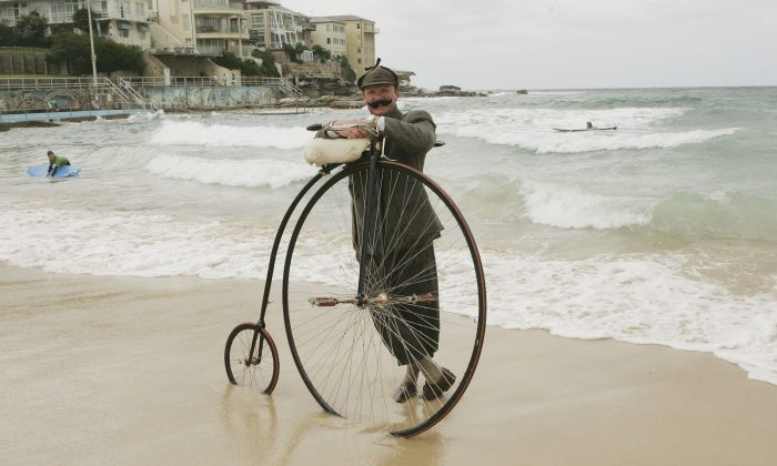Lloyd Scott poses in the surf on Bondi Beach with his Penny Farthing bicycle, after he finished his trip from Perth to Sydney on December 2, 2004 in Sydney, Australia. (Patrick Riviere/Getty Images)