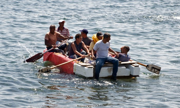 Seven would-be Cuban emigres remain in a homemade boat moments before being arrested by Cuban military agents after their attempt to escape from the island nation was thwarted by the sea currents, on June 4, 2009 in Havana. (Adalberto Roque/AFP/Getty Images)