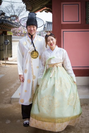 A couple wears traditional Korean  clothing while visiting the Seongyojang House in the  eastern city of Gangneung.