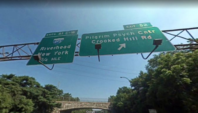 """A sign on the Sagtikos Parkway near Brentwood, NY, reads """"Crooked Hill Rd"""". A similar sign reported on June 16 to be defaced to read """"Crooked Hillary."""""""