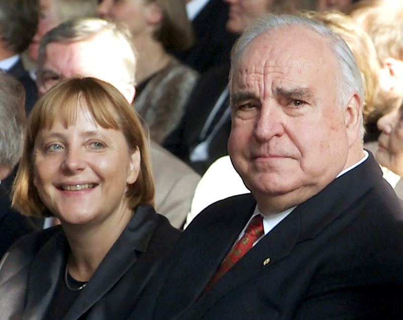 Former German Chancellor Helmut Kohl sits next to Christian Democrat party (CDU) leader Angela Merkel during celebrations to mark the 10th anniversary of German unification in Berlin on Sept. 27, 2000. (REUTERS/Michael Urban)