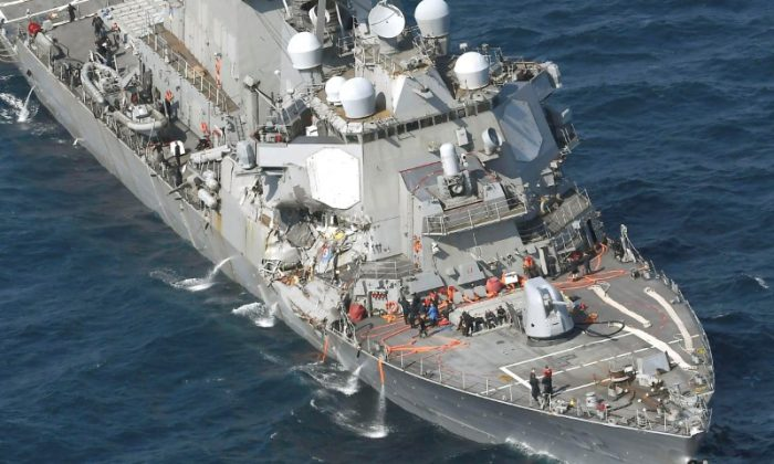 The Arleigh Burke-class guided-missile destroyer USS Fitzgerald. damaged by colliding with a Philippine-flagged merchant vessel. is seen off Shimoda, Japan in this photo taken by Kyodo on June 17, 2017. (Kyodo/via REUTERS)