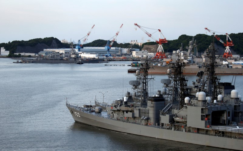 The Arleigh Burke-class guided-missile destroyer USS Fitzgerald, damaged by colliding with a Philippine-flagged merchant vessel, is towed into the U.S. naval base as Japanese Maritime Self-Defence Force (JMSDF) naval escort vessel Yamagiri is seen in front in Yokosuka, south of Tokyo, Japan on June 17, 2017. (REUTERS/Toru Hanai)