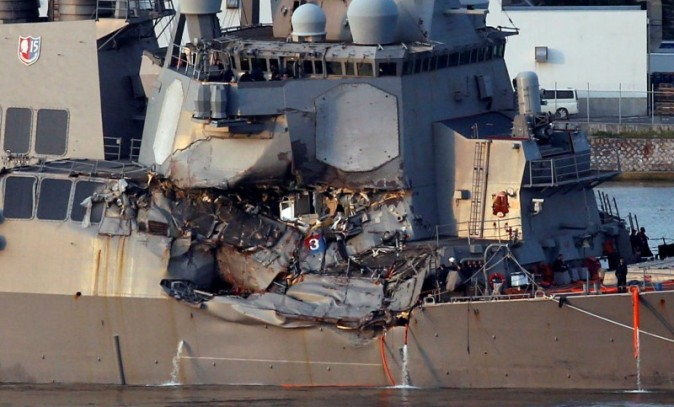 The Arleigh Burke-class guided-missile destroyer USS Fitzgerald, damaged by colliding with a Philippine-flagged merchant vessel, is towed into the U.S. naval base in Yokosuka, south of Tokyo, Japan June 17, 2017. REUTERS/Toru Hanai