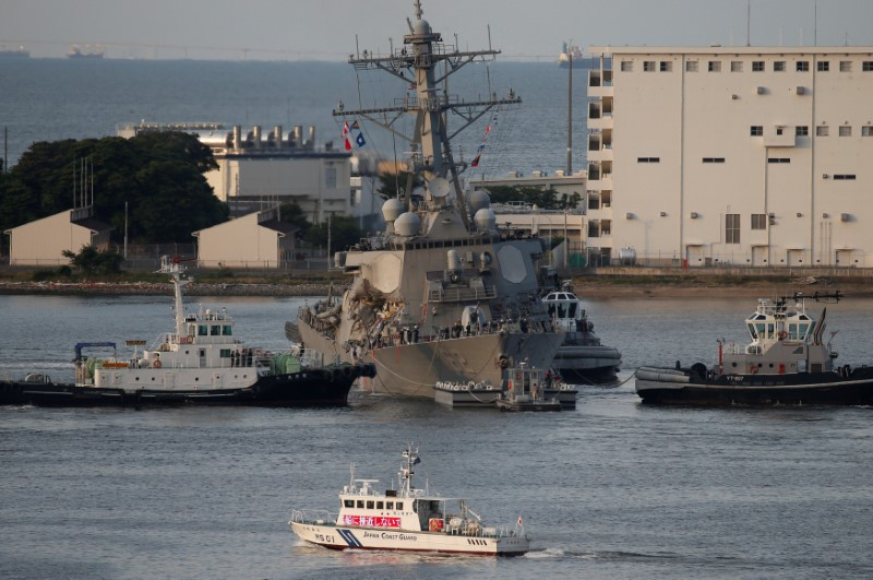 The Arleigh Burke-class guided-missile destroyer USS Fitzgerald, damaged by colliding with a Philippine-flagged merchant vessel, is towed by tugboats upon its arrival at the U.S. naval base in Yokosuka, south of Tokyo, Japan June 17, 2017. REUTERS/Toru Hanai