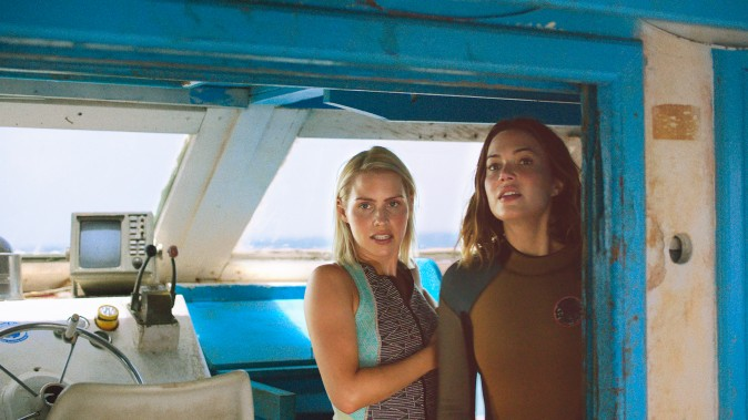 (L–R) Kate (Claire Holt) and Lisa (Mandy Moore) gather the courage to dive with sharks in