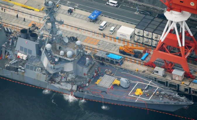 The Arleigh Burke-class guided-missile destroyer USS Fitzgerald, damaged by colliding with a Philippine-flagged merchant vessel, is seen at the U.S. naval base in Yokosuka, Japan, in this photo taken by Kyodo June 18, 2017.  (Kyodo/via Reuters)