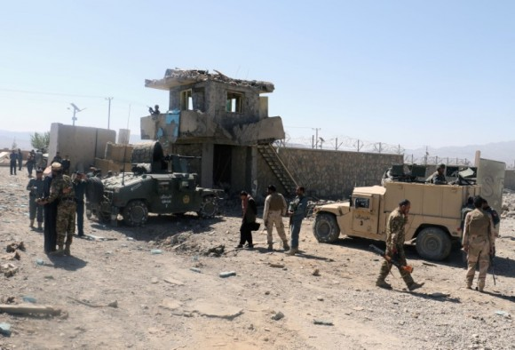 Afghan security forces inspect the aftermath of a suicide bomb blast in Paktia Province, Afghanistan June 18, 2017. (Reuters/Samiullah Peiwand)