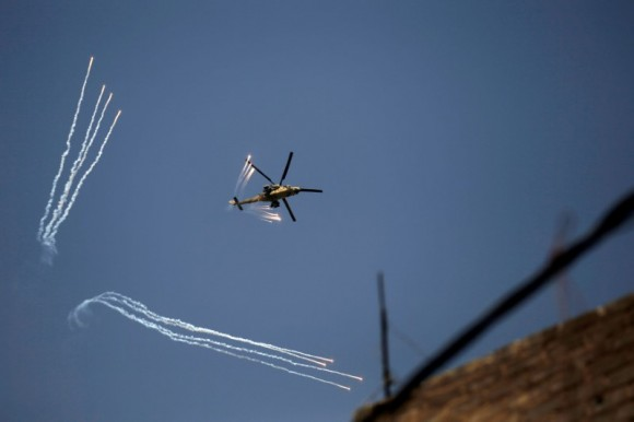 An Iraqi Army helicopter launches decoy flares over western Mosul, Iraq June 17, 2017. REUTERS/Alkis Konstantinidis