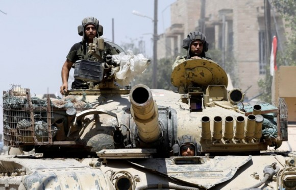 Iraqi soldiers look out from a tank as they advances towards the Islamic State militants positions in the Old City in western Mosul, Iraq June 18, 2017. (Reuters/Erik De Castro)