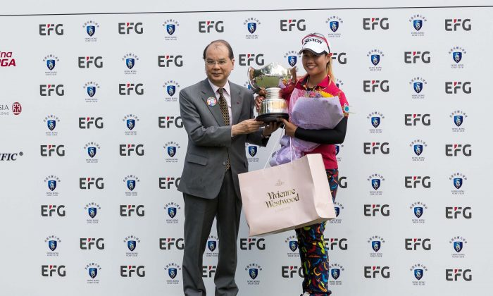 Thailand's Supamas Sangchan receives her trophy and prizes from HK Government representations Matthew Cheung, after winning the 2017 EFG Hong Kong Ladies at Fanling on Sunday June 11. She also collected a winner's cheque for HK$175,000 presented by Albert Chiu of EFG. (Dan Marchant)