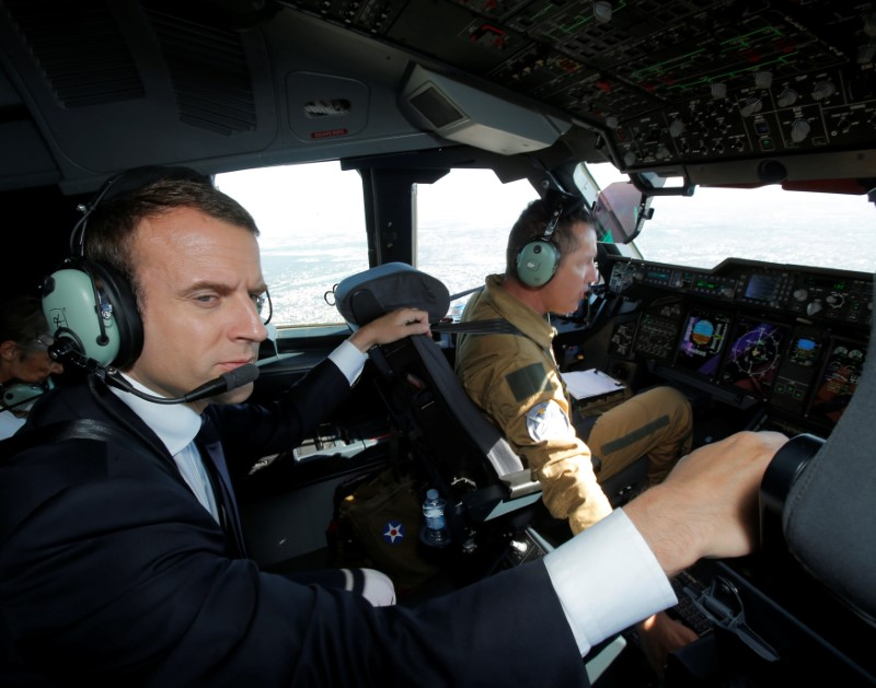 French President Emmanuel Macron sits in the cockpit of an Airbus A400M turboprop transport plane before taking off from Villacoublay military airbase near Paris, France, June 19, 2017. REUTERS/Michel Euler/Pool