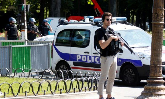 French police secure the area on the Champs Elysees avenue after an incident in Paris, France, June 19, 2017. (REUTERS/Charles Platiau)
