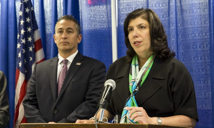 Nassau County District Attorney Madeline Singas and Assistant Special Agent in charge of Homeland Security Investigations, New York, Jason Molina (3rd L), at a press conference to announce the 85-count indictment of 41 alleged MS-13 gang members in Nassau County, Long Island, N.Y., on June 15, 2017.