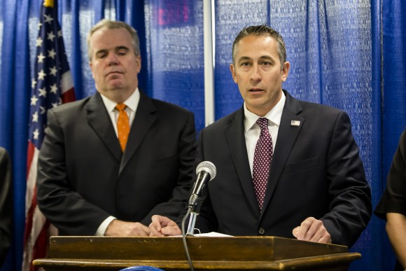 Assistant Special Agent in charge of Homeland Security Investigations, New York, Jason Molina (R) and Nassau Police Commissioner Thomas Krumpter at a press conference to announce the 85-count indictment of 41 alleged MS-13 gang members in Nassau County, Long Island, N.Y., on June 15, 2017. (Samira Bouaou/The Epoch Times)