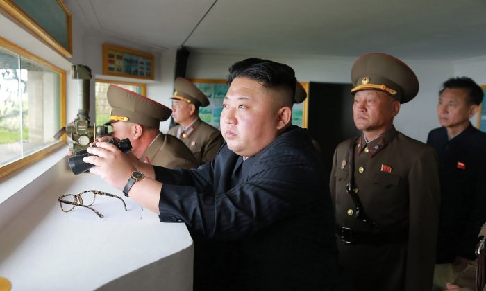 An undated picture of North Korean leader Kim Jong-Un (C) released from North Korea's official Korean Central News Agency on May 5. (STR/AFP/Getty Images)