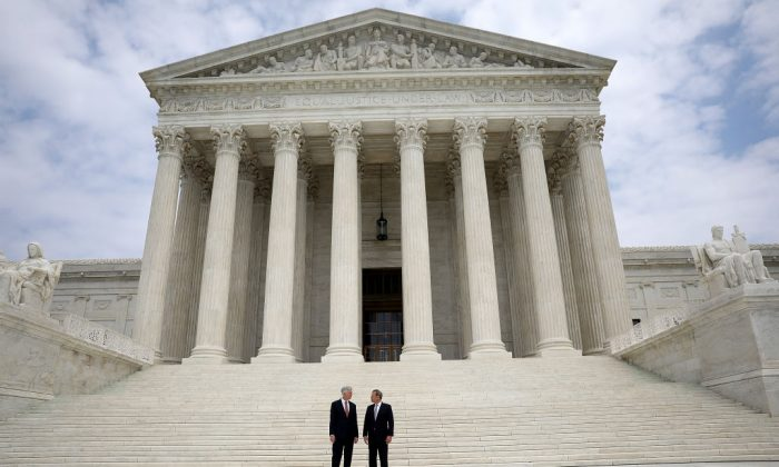 Supreme Court Justice Neil Gorsuch (L) stands with Chief Justice John Roberts (R) at the Supreme Court June 15, 2017 in Washington, DC.  (Win McNamee/Getty Images)