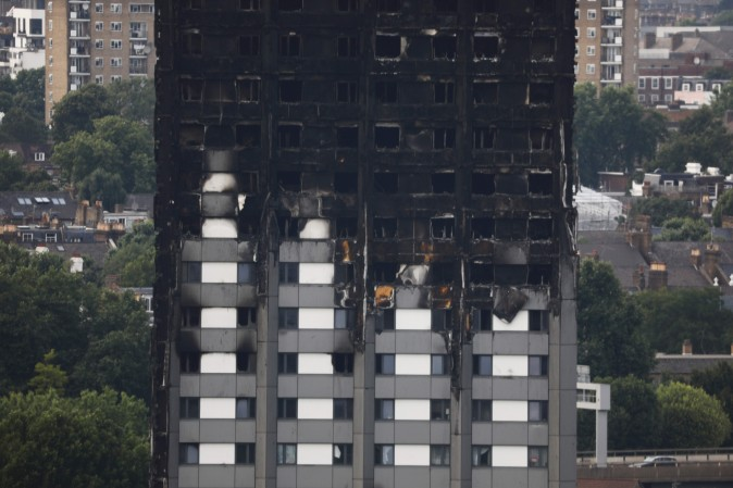 Unburned lower floors with untouched cladding in place are seen with the burnt out upper floors of the Grenfell Tower block in North Kensington, west London, on June 18, 2017. (Tolga Akmen/AFP/Getty Images)