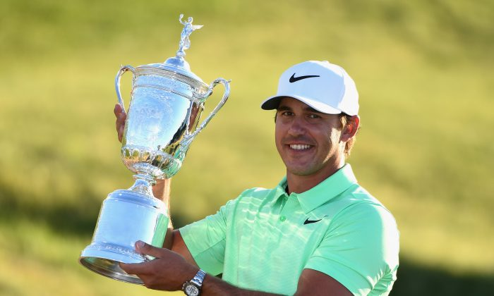 Brooks Koepka celebrates with the champion's trophy after the final round of the 2017 U.S. Open at Erin Hills in Hartford, Wisconsin on June 18, 2017.  (Ross Kinnaird/Getty Images)