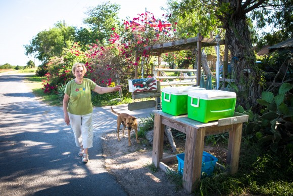 "Pamela Taylor leaves coolers with ice and drinks next to her mailbox for Border Patrol, illegal immigrants, and ""anyone else who is thirsty,"" in Brownsville, Texas, on June 1, 2017. (Benjamin Chasteen/The Epoch Times)"