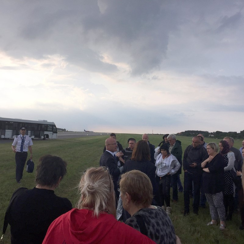 Passengers stand on the grass next to a runway after being evacuated from a Scandinavian Airlines Systems plane which was forced to make an emergency landing shortly after takeoff due to smoke in the cabin, at Gdansk airport, Poland  June 20, 2017, in this picture obtained from social media.   Sergey Shtypuliak via REUTERS    NO RESALES. NO ARCHIVES.    THIS IMAGE HAS BEEN SUPPLIED BY A THIRD PARTY.    MANDATORY CREDIT