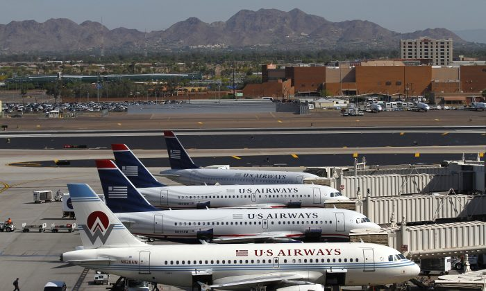 US Airways airplanes sit at terminal four gates at Sky Harbor International Airport in Phoenix, Arizona in this file photo. (Joshua Lott/Getty Images)