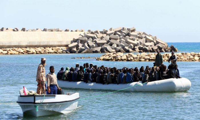 Illegal migrants from Africa arrive ashore after being rescued by Libyan coast guards at sea, off the coastal town of Guarabouli, 36 miles east of the capital Tripoli on May 18, 2017. (Mahmud Turkia/AFP/Getty Images)